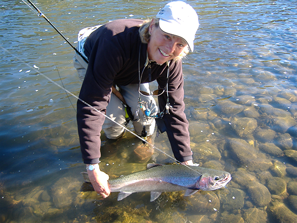 Woman-with-fish-and-rod
